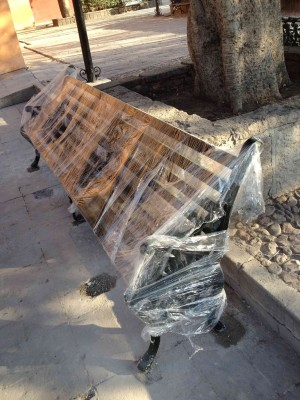Benches, benches, everywhere: new bench being installed at San Juan de Dios plaza.