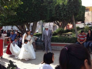 A bride and her flower girl make their way through San Antonio plaza in San Miguel de Allende.