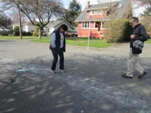 Victoria City Councillor Charlayne Thornton-Joe tries out hopscotch on Carroll St.