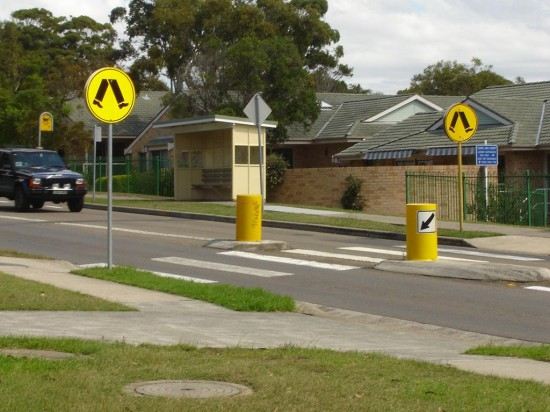 A crossing with mid-street pedestrian refuge and signage, in Australia.  (image: MorgueFile)