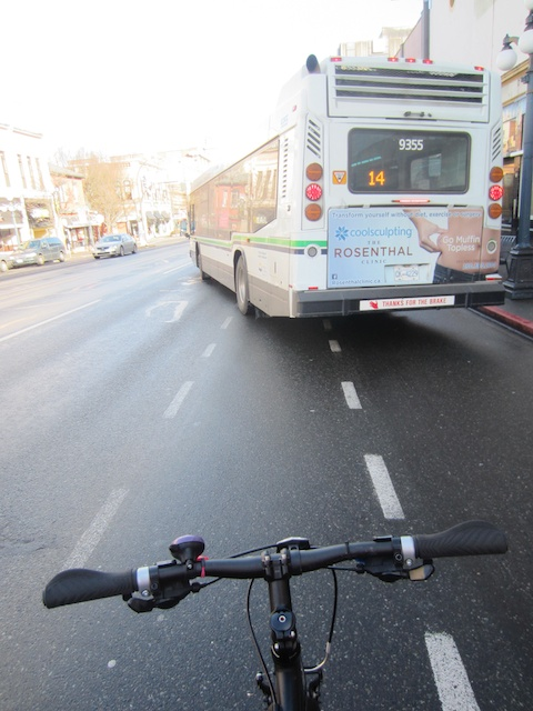 A bike lane in theory only? Cyclists are often vulnerable on lanes with minimal marking & no barriers. photo credit: Sarah Rose Robert