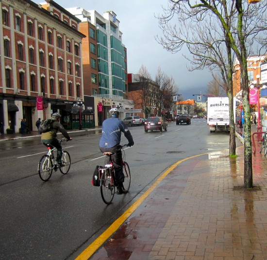 Cyclists on the morning commute, Yates St., downtown Victoria