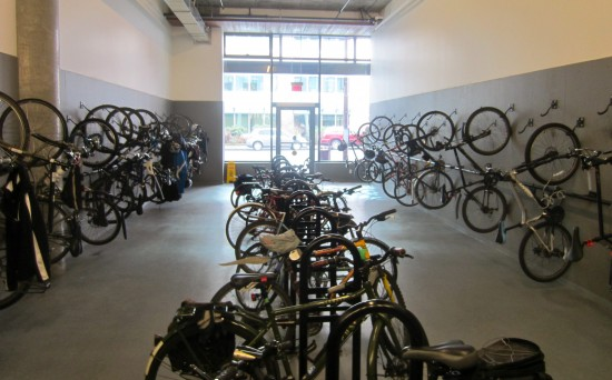 Well used, secure and convenient indoor bike parking at Atrium Building, downtown Victoria.
