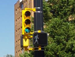 Dedicated cycle signal alongside pedestrian signal.