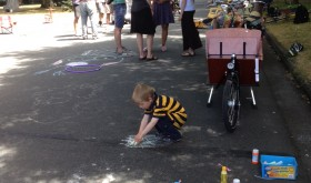 Bubble makers and chalk art start to soften the look of the street.