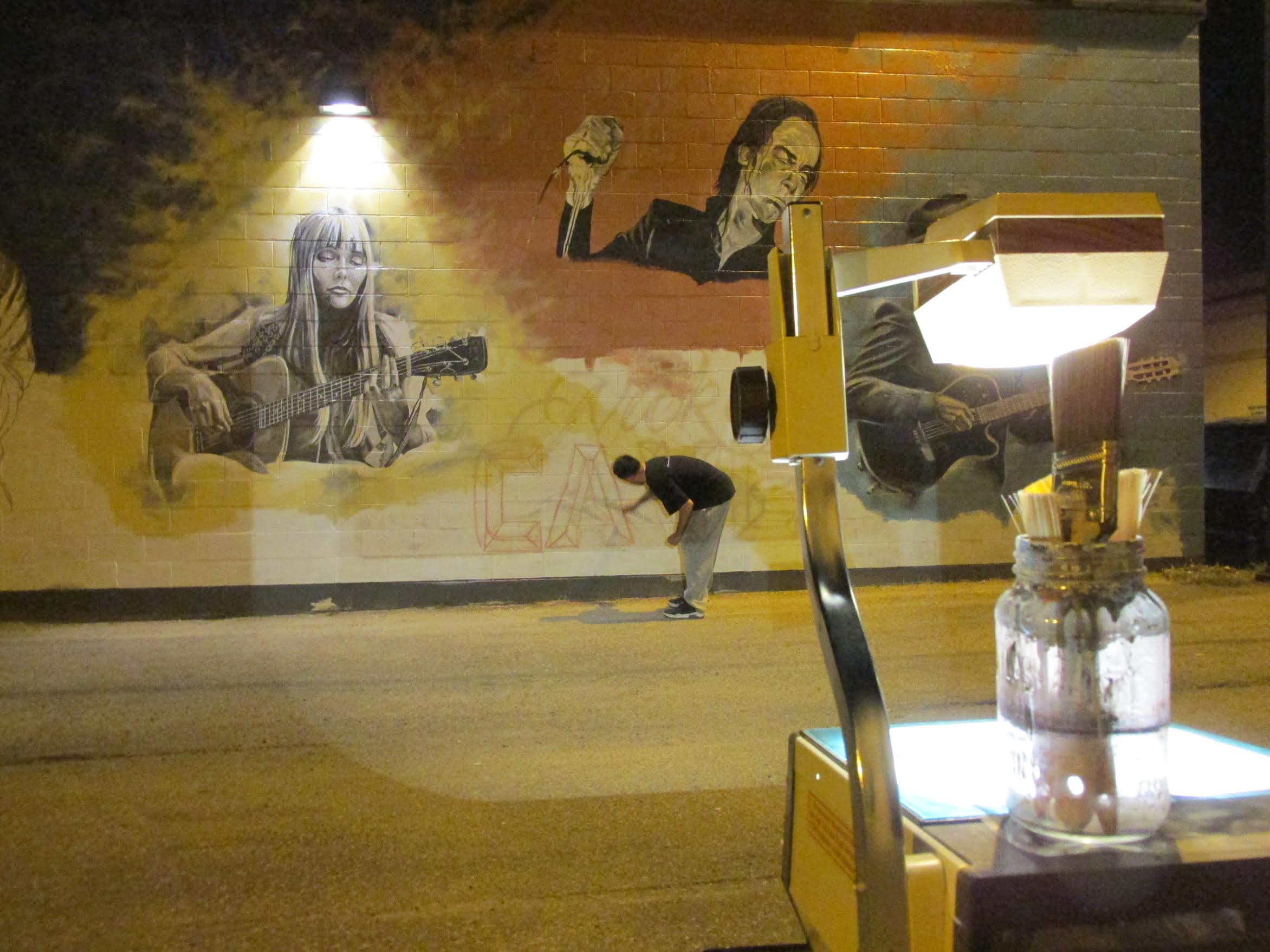"A different kind of night life: creative work underway in ""Art Alley""."